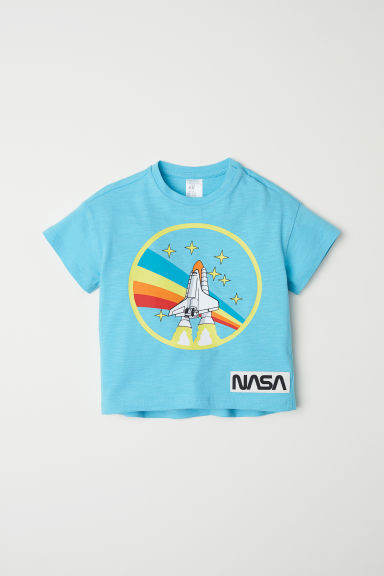 T-shirt with a print motif - Light blue/Rocket - Kids | H&M CN