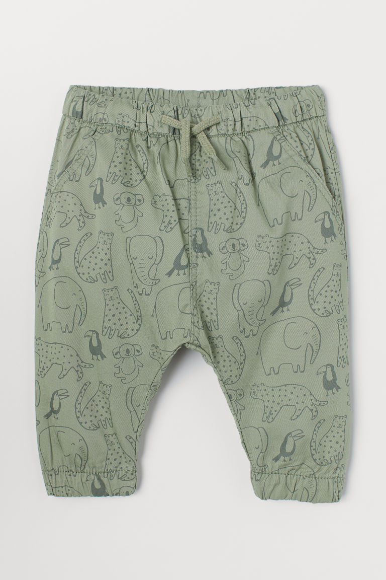 Twill pull-on trousers - Green/Animals - Kids | H&M IN