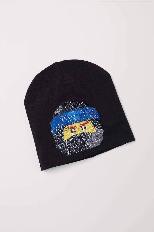 d3a6139ed1e Hat with reversible sequins - Black Ninjago - Kids