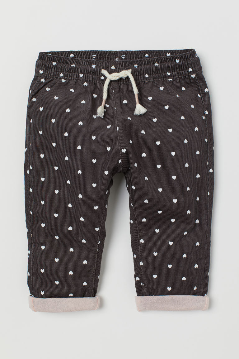 Lined corduroy trousers - Dark grey/Hearts - Kids | H&M IN