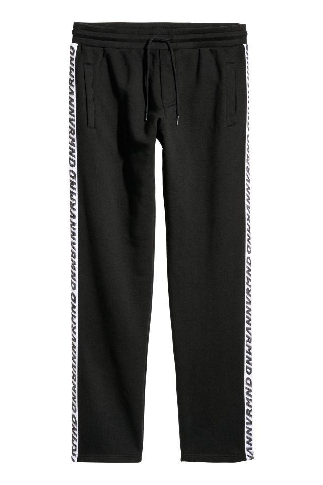 34e6e2829 Sweatpants with side stripes - Black - Men
