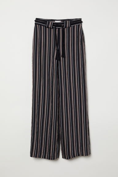 Pantaloni ampi con cintura - Nero/righe - DONNA | H&M IT