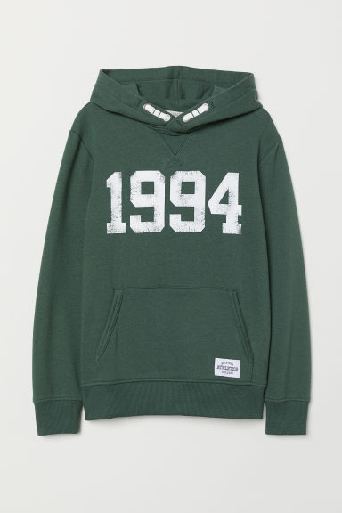 Hooded top with a text motif - Dark green/1994 - Kids | H&M CN
