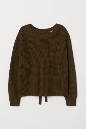 Ribbed jumper with lacingModel