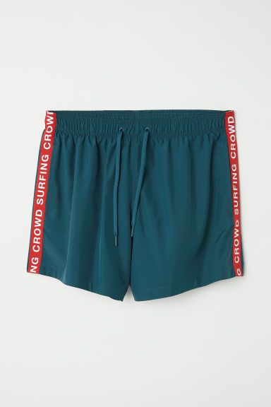 Swim shorts with side stripes - Dark turquoise - Men | H&M