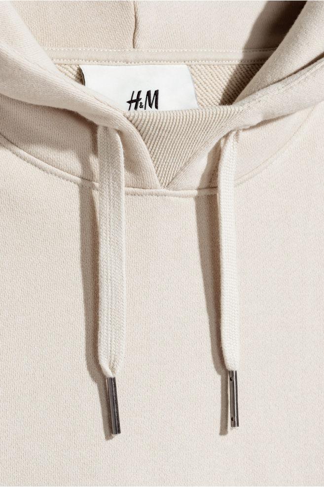 f3fb262568ab ... Cotton Hooded Sweatshirt - Light beige - Men | H&M ...