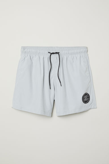 Swim shorts with a print motif - Light grey - Men | H&M