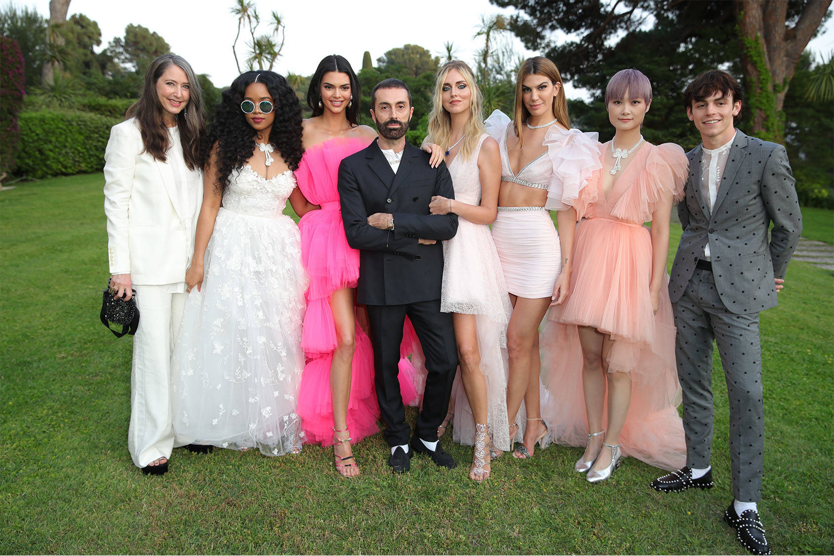 Giambattista Valli at the amfAR gala together with his muses: H.E.R, Kendall Jenner, Chiara Ferragni, Bianca Brandolini, Chris Lee and Ross Lynch. All wearing full looks from the limited edition collection, available online and in stores 25 May.