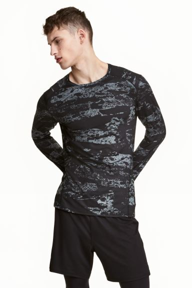 Sportshirt Muscle Fit - Schwarz/Gemustert - Men | H&M AT