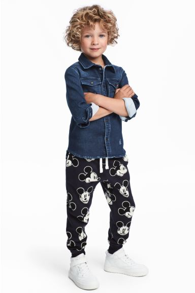 Patterned joggers - Dark blue/Mickey Mouse - Kids | H&M GB