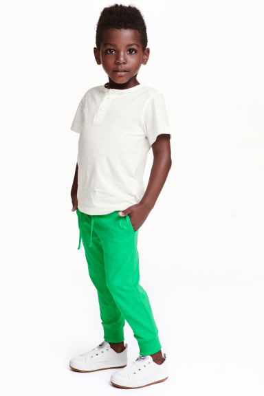 Cotton jersey joggers - Green - Kids | H&M GB