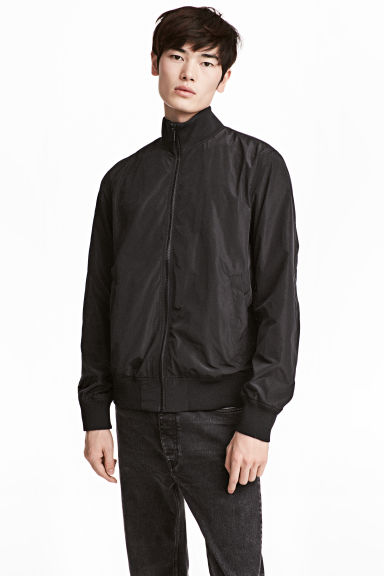 Jacket with a stand-up collar - Black -  | H&M CN