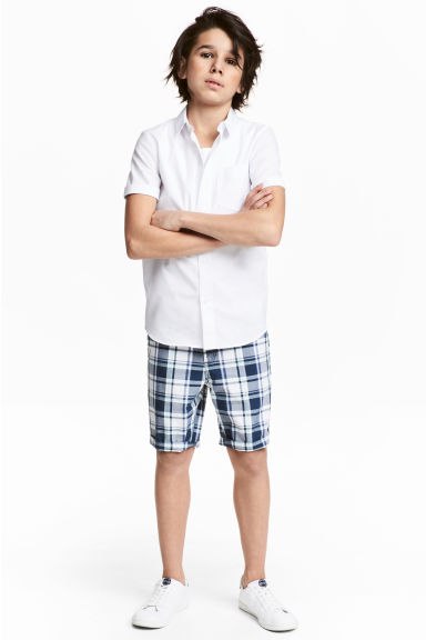 Shorts with a belt - Dark blue/Checked - Kids | H&M