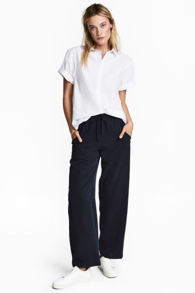 Wide lyocell trousers - Dark blue -  | H&M
