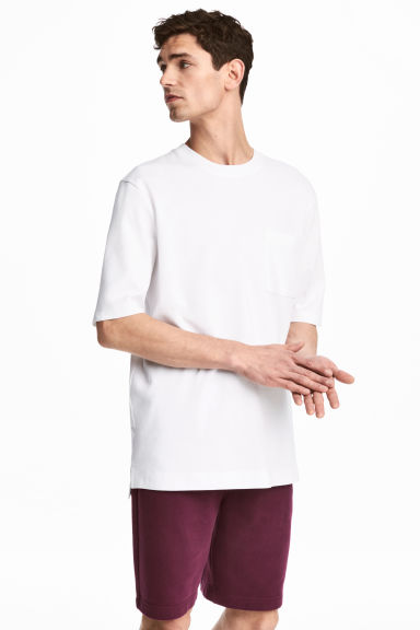 T-shirt with a chest pocket - White -  | H&M CN