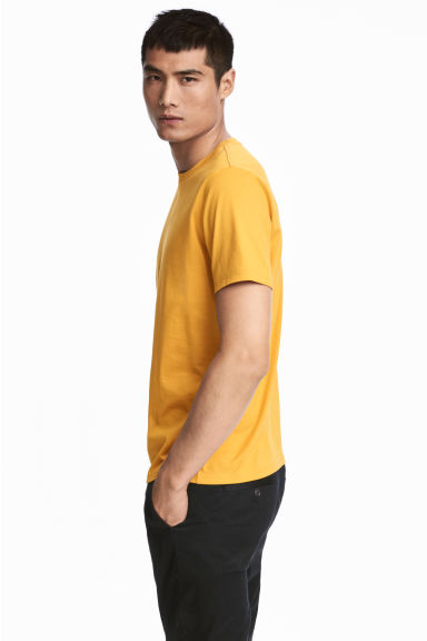 Premium cotton T-shirt - Mustard yellow - Men | H&M