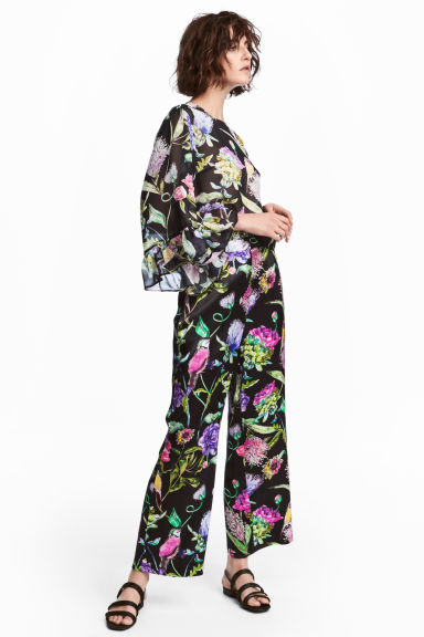 Wide trousers - Black/Floral -  | H&M