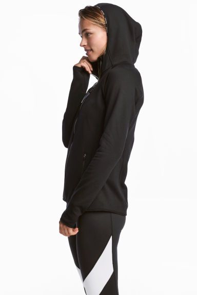 Fleece jacket with a hood - Black - Ladies | H&M CN