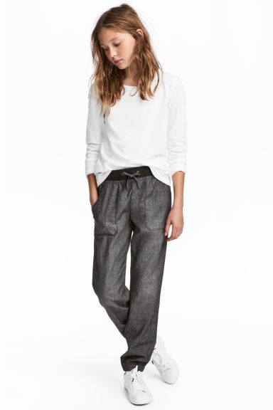 Dra-på-byxa - Svart washed out - BARN | H&M SE