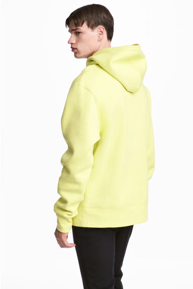 Oversized hooded top - Light yellow - Men | H&M IE