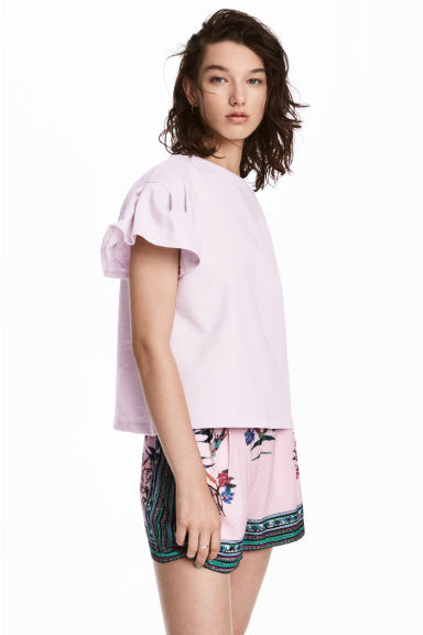 Top con maniche a volant - Rosa chiaro - DONNA | H&M IT