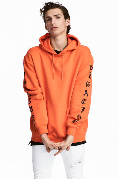 Hooded top with a print motif - Orange -  | H&M