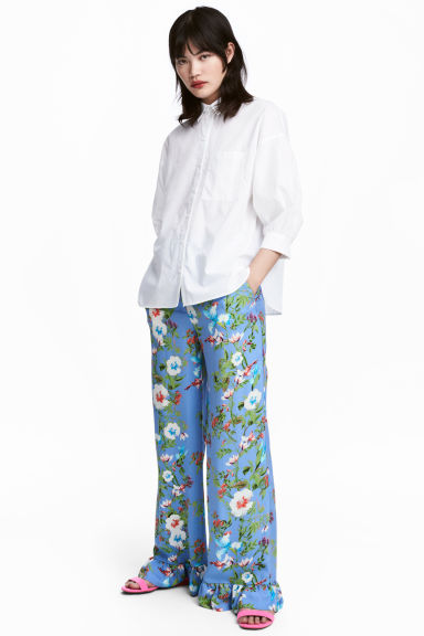 Wide frill-hemmed trousers - Blue/Floral - Ladies | H&M