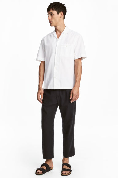 Wide linen-blend trousers - Black - Men | H&M
