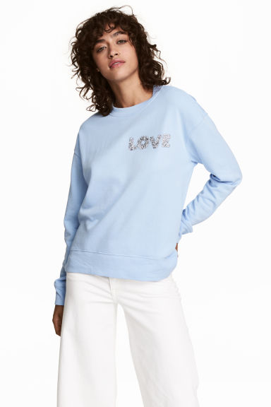 Sweatshirt with an appliqué - Light blue - Ladies | H&M