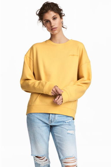 Sweater met borduursel - Geel/Possibilities - DAMES | H&M NL
