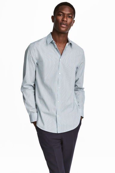 Cotton shirt Relaxed fit - Light blue/Striped - Men | H&M