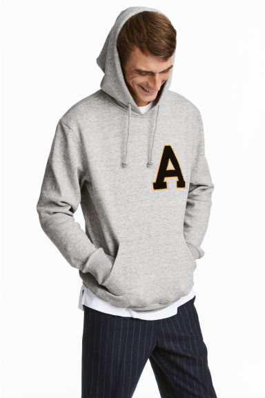Hooded top with a motif - Light grey marl - Men | H&M CN