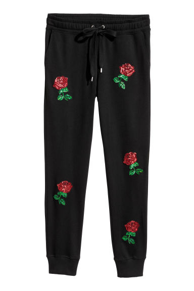 Embroidered joggers - Black/Roses - Ladies | H&M