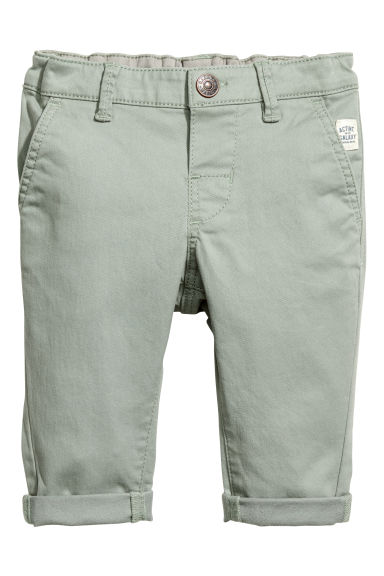 Chino en coton stretch - Vert kaki clair - ENFANT | H&M BE