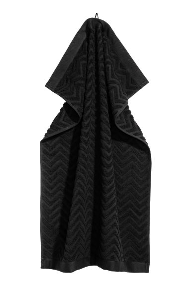 Jacquard-patterned hand towel - Black - Home All | H&M GB