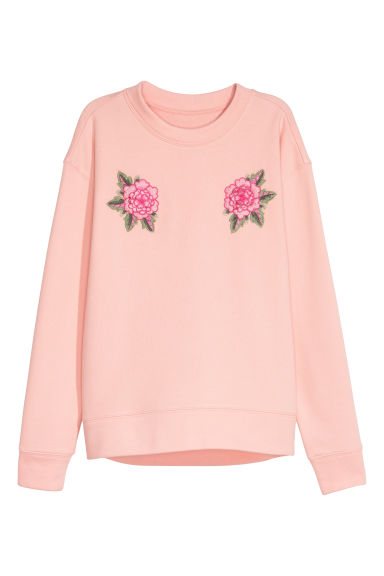 Sweatshirt with an appliqué - Powder pink -  | H&M IE
