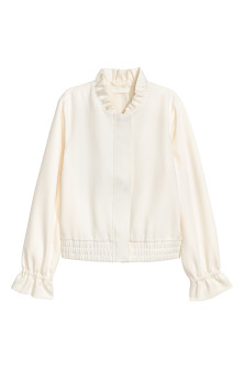 Jacket with a frilled collar