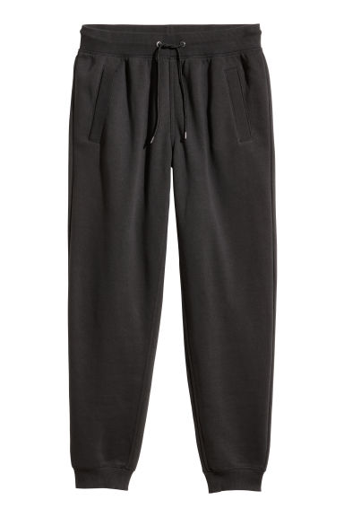 Pantaloni in felpa Regular fit - Nero - UOMO | H&M IT