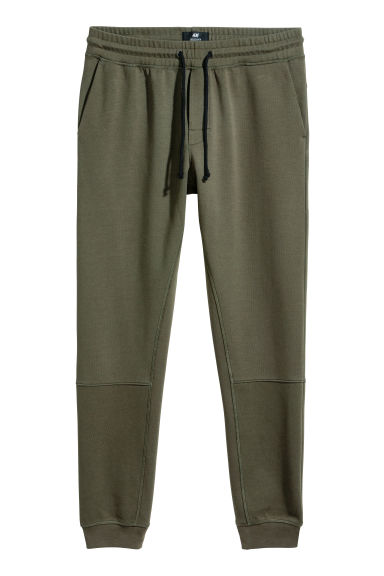 Tapered fit Joggers - Dark green - Men | H&M CN